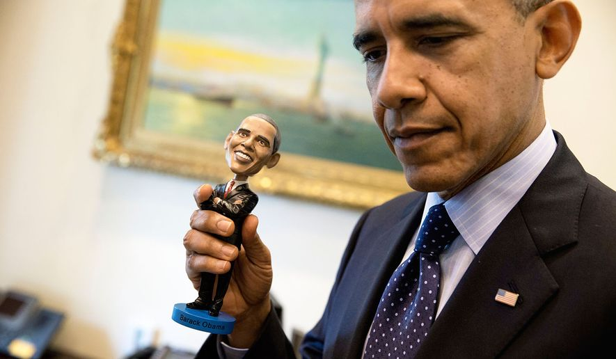 President Barack Obama holds a bobblehead doll of himself in the Outer Oval Office, May 14, 2014. (Official White House Photo by Pete Souza)