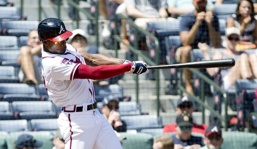 Atlanta Braves' B.J. Upton (2) follows through on a two-run home run in the second inning of a baseball game against the Philadelphia Phillies Wednesday, Sept. 3, 2014, in Atlanta. (AP Photo/John Bazemore)