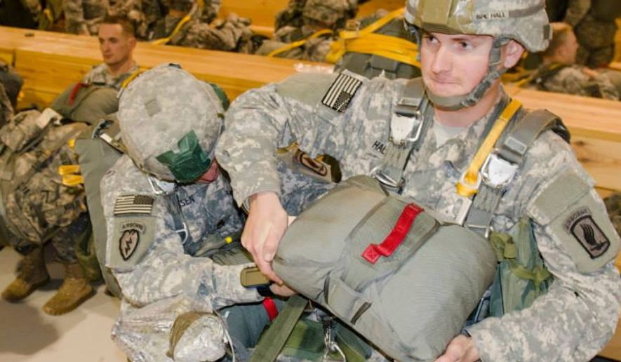 ** FILE ** Paratroopers from The 173rd Airborne Brigade Combat Team prepared for and executed a test of its contingency response abilities here Nov. 21, 2013 at Aviano Air Base, Italy. (U.S. Army)
