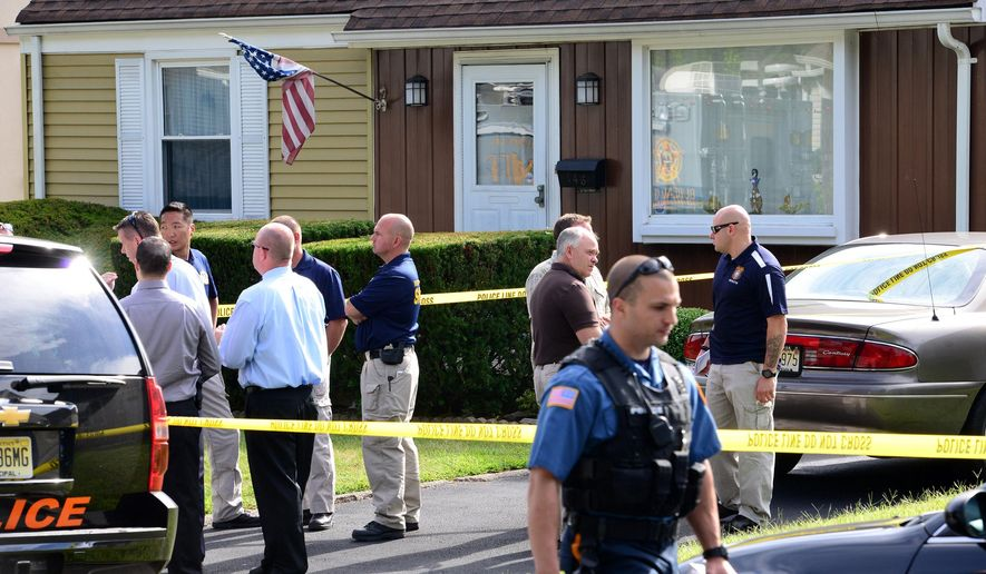 Police mill about outside a home in Hasbrouck Heights, N.J., Wednesday, Sept. 3, 2014, where they say an elderly man fatally shot his wife and brother-in-law before turning the gun on himself. (AP Photo/The Record of Bergen County, Tariq Zehawi) ONLINE OUT; MAGS OUT; TV OUT; INTERNET OUT;  NO ARCHIVING; MANDATORY CREDIT