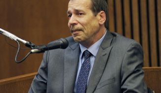 FILE - In this Aug. 4, 2014 file photo, Theodore Wafer, of Dearborn Heights, Mich., testifies in his own defense during his trial for the Nov. 2, 2013, killing of Renisha McBride in Detroit. Wafer was sentenced WednesdaySept. 3, 2014 to at least 17 years in prison for killing an unarmed woman who appeared on his porch before dawn. (AP Photo/Detroit News, Clarence Tabb Jr., File)