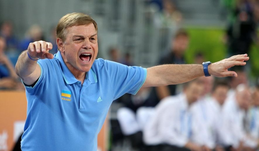 FILE - In a Sept. 21, 2013, file photo Ukraine's head coach Mike Fratello, from the U.S., instructs his players against Slovenia during their EuroBasket European Basketball Championship match at the Stozice Arena, in Ljubljana, Slovenia. Fratello got the language concern out of the way at his first meeting with players after taking over Ukraine's national team in 2011. If you didn't get what I just said, he told them, don't nod your head like you did.  (AP Photo/Thanassis Stavrakis, file,)