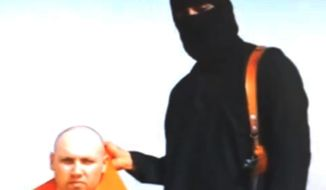 A still image from an undated video released by Islamic State militants shows journalist Steven Sotloff being held by the militant group. An Internet video purporting to show the beheading of U.S. journalist Sotloff by the Islamic State group was posted online Tuesday, a beheading described as retribution for continued U.S. airstrikes in Iraq. (AP Photo, File)