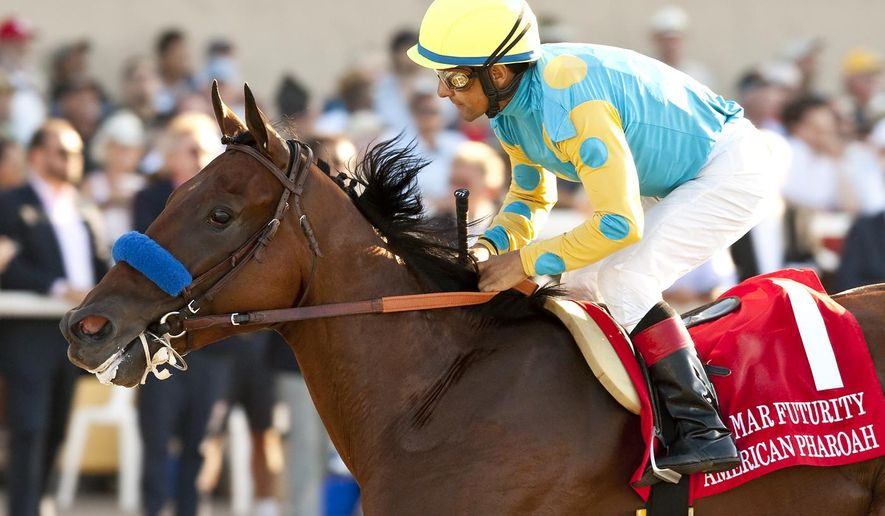 In a photo provided by Benoit Photo, American Pharoah, with jockey Victor Espinoza, wins the Grade I, $300,000 Del Mar Futurity horse race, Wednesday, Sept. 3, 2014, at Del Mar Thoroughbred Club in Del Mar, Calif. (AP Photo/Benoit Photo)