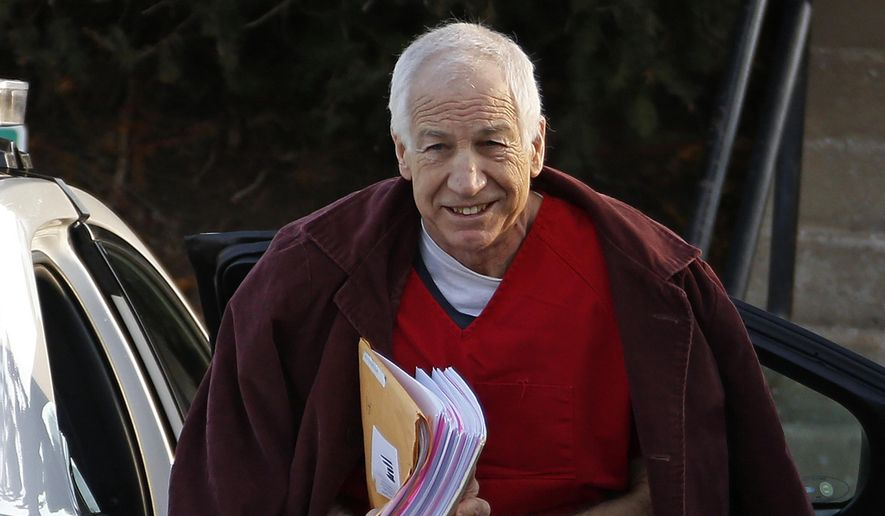 In this Jan. 10, 2013, file photo, former Penn State assistant football coach Jerry Sandusky arrives at the Centre County Courthouse for a post-sentencing hearing in Bellefonte, Pa. (AP Photo/Gene J. Puskar, File)