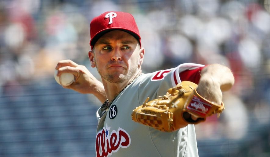 Philadelphia Phillies starting pitcher David Buchanan (55) works against the Atlanta Braves during the first inning of a baseball game Wednesday, Sept. 3, 2014, in Atlanta. (AP Photo/John Bazemore)