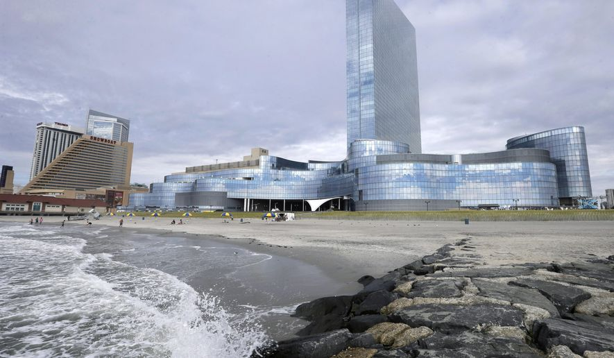 The Showboat Casino Hotel, which closed Sunday, is seen next to the Revel Casino Hotel, right, Monday, Sept. 1, 2014, in Atlantic City, N.J. The most spectacular and costly failure in Atlantic City's 36-year history of casino gambling began to play out Monday when the $2.4 billion Revel Casino Hotel emptied its hotel. Its casino will close early Tuesday morning. Revel is shutting down a little over two years after opening with high hopes of revitalizing Atlantic City's struggling gambling market. (AP Photo/Mel Evans)