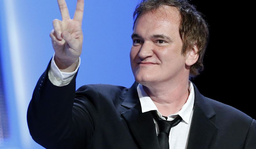 "FILE - In this Feb. 28, 2014 file photo, U.S director Quentin Tarantino shows a v-sign during the 39th Cesar Film Awards at Theatre du Chatelet in Paris, France. Tarantino is moving forward with ""The Hateful Eight.""  The Weinstein Company said Wednesday, Sept. 3, 2014, that production on ""Hateful Eight"" would begin in January 2015.  (AP Photo/Jacques Brinon, file)"