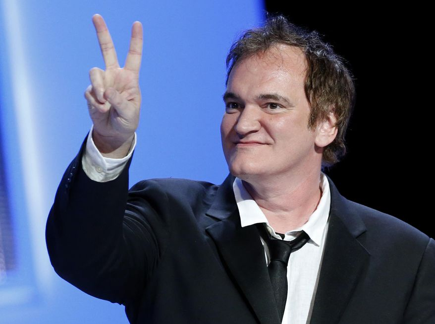 """FILE - In this Feb. 28, 2014 file photo, U.S director Quentin Tarantino shows a v-sign during the 39th Cesar Film Awards at Theatre du Chatelet in Paris, France. Tarantino is moving forward with """"The Hateful Eight.""""  The Weinstein Company said Wednesday, Sept. 3, 2014, that production on """"Hateful Eight"""" would begin in January 2015.  (AP Photo/Jacques Brinon, file)"""