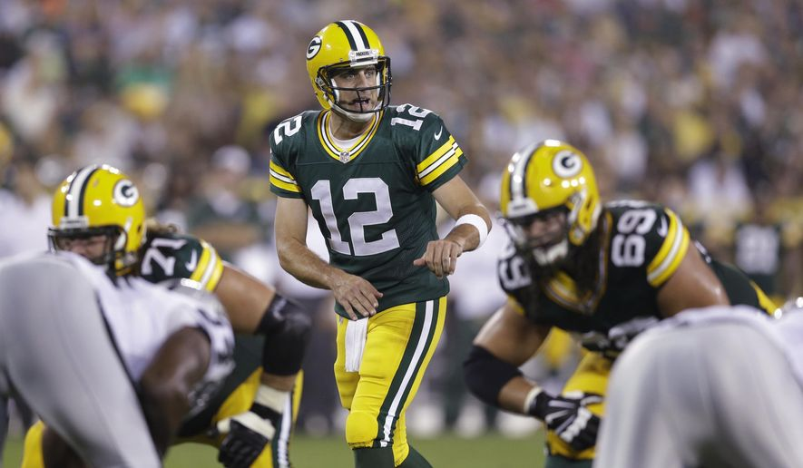 In this Aug. 22, 2014, photo, Green Bay Packers quarterback Aaron Rodgers approaches the line of scrimmage during the first half of an NFL preseason football game against the Oakland Raiders in Green Bay, Wis. Rodgers' first start at Seattle is making a lot of fantasy football owners squeamish. (AP Photo/Morry Gash)