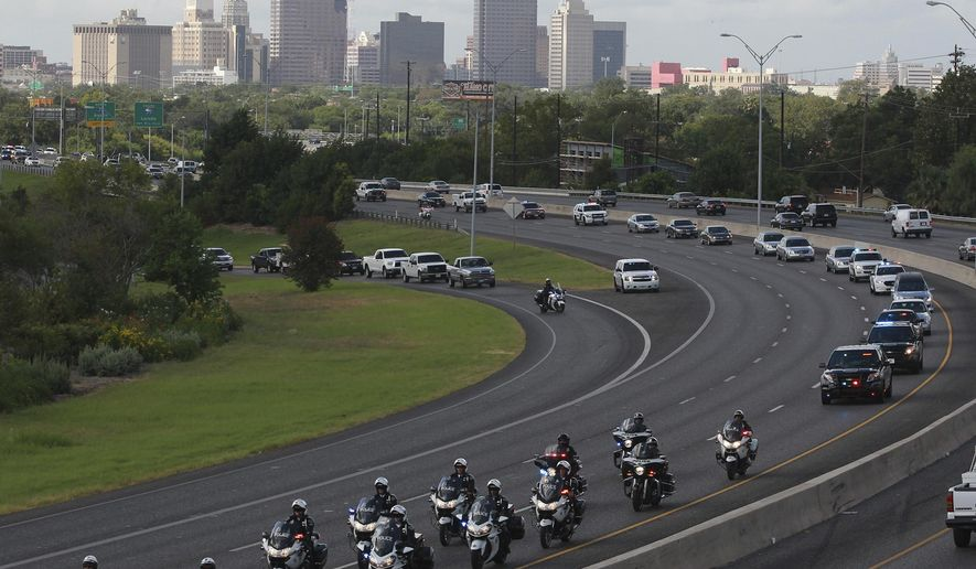 The funeral procession for former Elmendorf Police Chief Michael Pimentel winds its way north Tuesday, Sept. 2, 2014. Pimentel was shot to death during a traffic stop. (AP Photo/San Antonio Express-News, John Davenport) MAGS OUT NO SALES SAN ANTONIO OUT