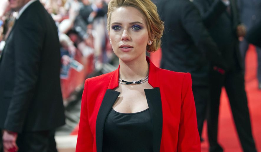 """FILE - In this March 17, 2014 file photo, US actress Scarlett Johansson arrives on the red carpet for the French premiere of the film """"Captain America: The Winter Soldier,"""" at the Rex Cinema,  in Paris. To keep private pictures private, never upload them online. That's the advice experts offer after hackers broke into female celebrities' personal accounts, stole nude photos and posted them online.  Even though such hacking is illegal - the man who stole nude photos of Johansson was convicted of federal wiretapping and unauthorized access to a computer - ensuring that all the illicit images are removed from all the sites that posted them is a never-ending challenge that one expert likened to a game of """"whack-a-mole."""" (AP Photo/Jacques Brinon, file)"""