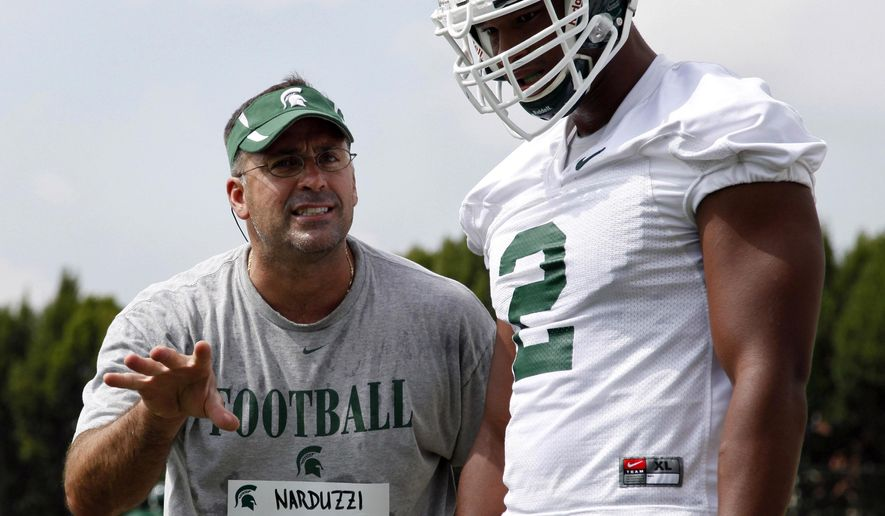 FILE - In this Aug. 7, 2011, file photo, Michigan State defensive coordinator Pat Narduzzi, left, gives instructions to defensive end William Gholston during the team's first NCAA college football practice of the season in East Lansing, Mich. Oregon is one of the toughest teams in the country to prepare for, but if anyone is up to the task, it may be Narduzzi, whose Spartans will take on the Ducks this weekend. (AP Photo/Al Goldis, File)