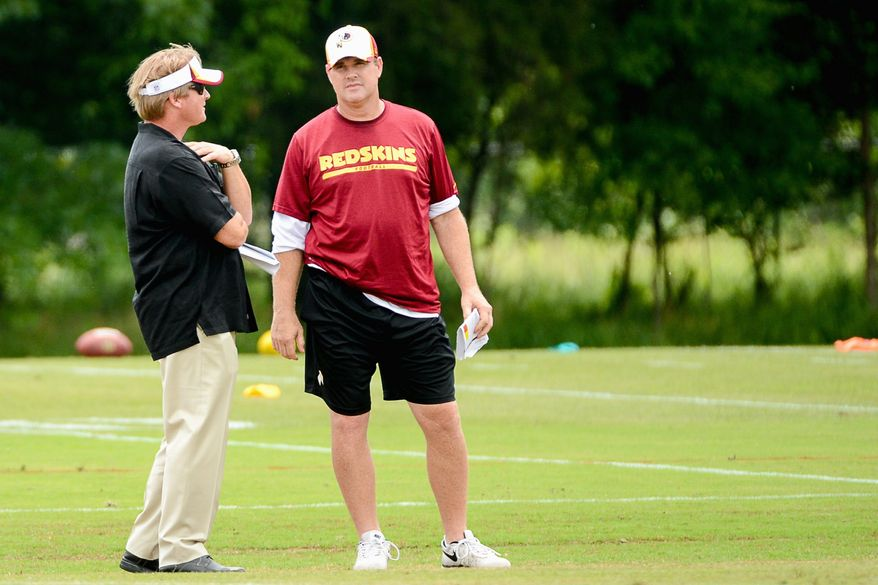 Gruden was an offensive assistant with the Tampa Bay Buccaneers (2002-2008) under brother Jon (left). (ANDREW HARNIK/The Washington Times)