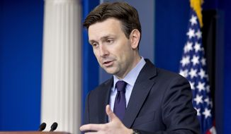 White House press secretary Josh Earnest speaks about the militant group al-Shabab in Somalia, during his daily news briefing at the White House in Washington, Tuesday, Sept. 2, 2014. Earnest also spoke about reports that a video on the internet that purports to show beheading of US reporter Steven Sotloff by Islamic State group. (AP Photo/Jacquelyn Martin)
