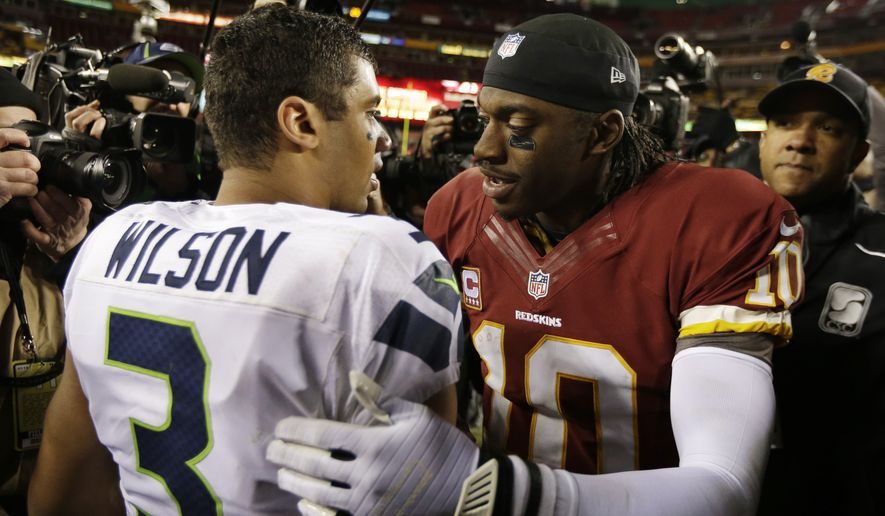 Seattle Seahawks quarterback Russell Wilson greets Washington Redskins quarterback Robert Griffin III after an NFL wild card playoff football game in Landover, Md., Sunday, Jan. 6, 2013. The Seahawks defeated the Redskins 24-14. (AP Photo/Evan Vucci)