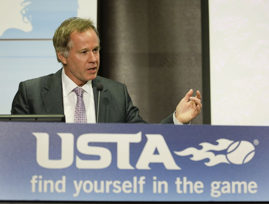 **FILE** Patrick McEnroe, general manager for player development with the United States Tennis Association makes remarks during a news conference to announce that the USTA plans to create a new, state-of-the-art facility in Lake Nona in Orlando that will feature a 100-plus court tennis center and create over 150 new jobs, Wednesday, May 14, 2014, in Orlando, Fla. (AP Photo)