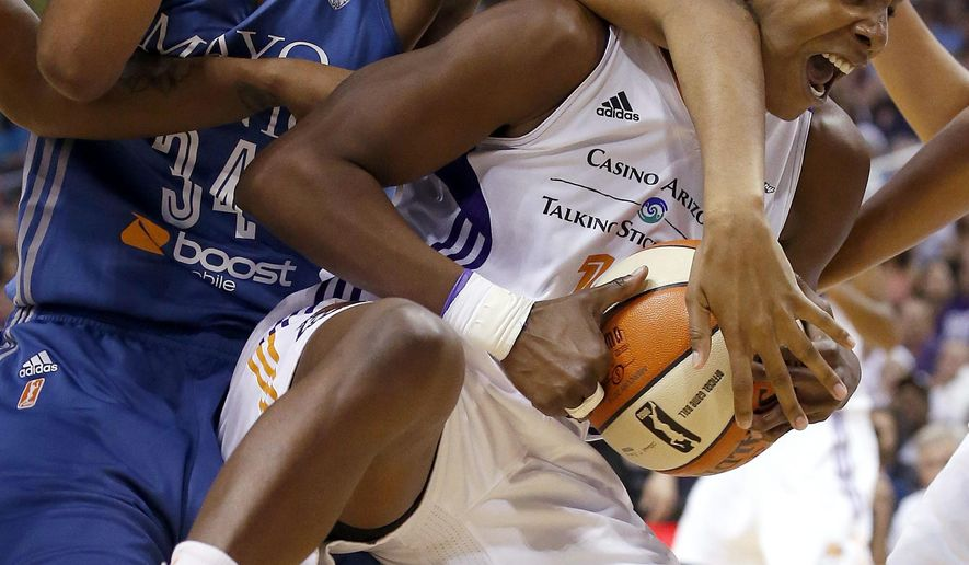 Phoenix Mercury's Eshaya Murphy, right, grabs a rebound in front of Minnesota Lynx's Damiris Dantas (34) during the first half of Game 3 in the WNBA Western Conference basketball finals Tuesday, Sept. 2, 2014, in Phoenix. (AP Photo/Ross D. Franklin)