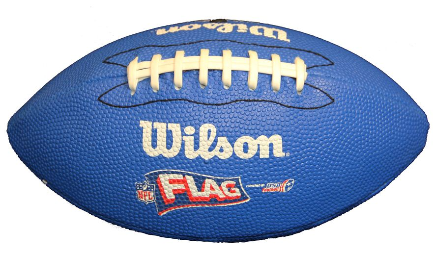 This image provided by USA Football shows a flag football. The NFL wants to boost flag football participation by providing kits to a half-million youngsters. A program being announced Wednesday, Sept. 3, 2014, by Commissioner Roger Goodell will supply elementary schools and after-school programs nationwide with equipment and instruction. Six cities are targeted as focal points this year: Chicago, Dallas, Los Angeles, Miami, New York and Seattle. (AP Photo/USA Football)