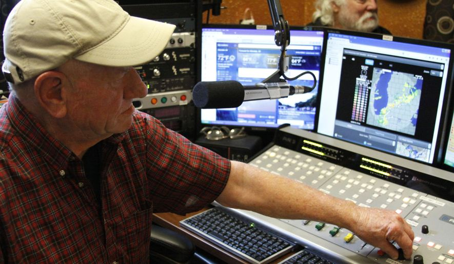 "In this Aug. 19, 2014 photo, Jim ""JC"" Cox, radio personality, works at the new 98.9 FM Real Gold Radio station in Whitehall, Mich. He's on the air from 7 a.m. to 10 a.m. Monday through Friday for the new station while Big John works the evening shift from 3 to 6 PM out of a room in the garage of his home. ""It can run by itself for many many months without touching it,"" said Cox. (AP Photo/Muskegon Chronicle - MLive.com, Andraya Croft)"