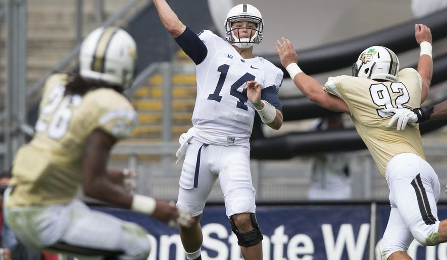 Penn State quarterback Christian Hackenberg throws a 79-yard touchdown pass to wide receiver Geno Lewis during the third quarter of an NCAA college football game against UCF on Saturday, Aug. 30, 2014, in Dublin. Penn State won 26-24. (AP Photo/PennLive.com, Joe Hermitt)