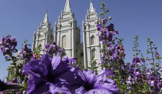 "Flowers bloom in front of the Salt Lake Temple in Temple Square in Salt Lake City on Wednesday, Sept. 3, 2014. The Church of Jesus Christ of Latter-day Saints on Wednesday unveiled a new collection that features some of the faith's most treasured artifacts, including a page from the original Book of Mormon manuscript written by founder Joseph Smith. The ""Foundations of Faith"" exhibit that opens to the public this week in the church's history library in Salt Lake City. (AP Photo/Rick Bowmer)"