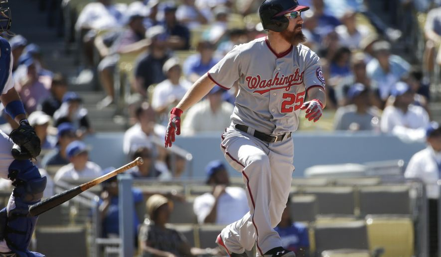 Washington Nationals' Adam LaRoche hits a two-run home run to tie the game during the ninth inning of a baseball game against the Los Angeles Dodgers Wednesday, Sept. 3, 2014, in Los Angeles. (AP Photo/Jae C. Hong)
