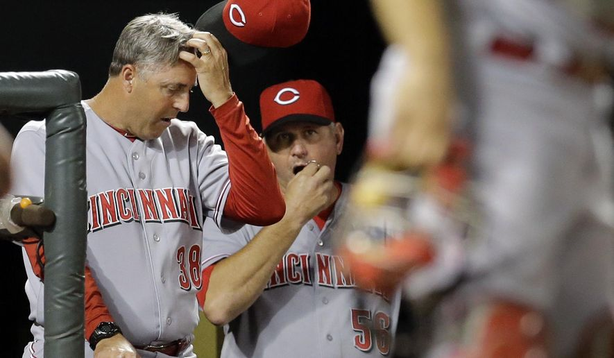 Cincinnati Reds manager Bryan Price, left, and pitching coach Jeff Pico stand in the dugout in the seventh inning of an interleague baseball game against the Baltimore Orioles, Wednesday, Sept. 3, 2014, in Baltimore. Baltimore won 6-0. (AP Photo/Patrick Semansky)