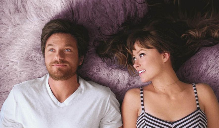 """This photo provided by courtesy of Gravitas Ventures shows Jason Bateman, left, and Olivia Wilde, in a scene from the film, """"The Longest Week.""""  (AP Photo/Courtesy Gravitas Ventures)"""