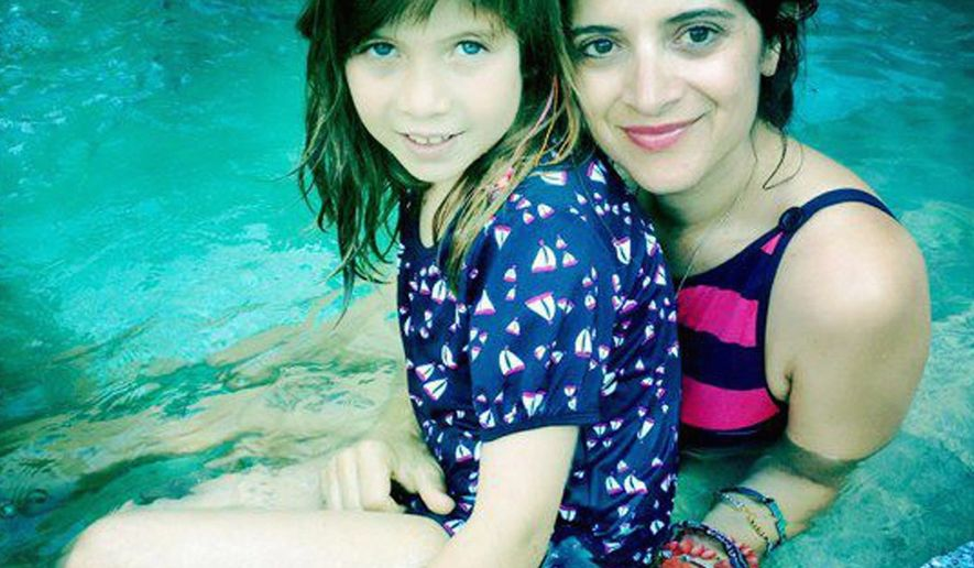 Melissa Sarkis-Kirby, seen with her daughter Colette, suffered a brain stem stroke in April. She is in rehab in Towson, Maryland. (Family photograph)