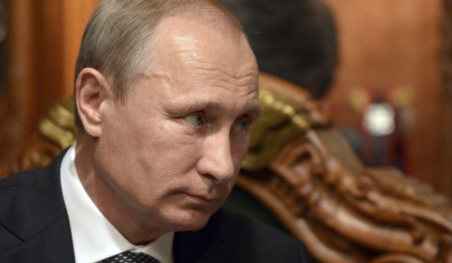 Russian President Vladimir Putin attends a meeting in Ulan Bator, Mongolia, on Sept. 3, 2014. (Associated Press) ** FILE **