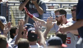 Washington Nationals' Adam LaRoche, right, celebrates his two-run home run with teammates in the dugout during the ninth inning of a baseball game against the Los Angeles Dodgers on Wednesday, Sept. 3, 2014, in Los Angeles. (AP Photo/Jae C. Hong)
