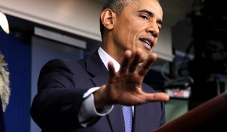 ** FILE **  President Obama speaks in the Brady Press Briefing Room of the White House in Washington, Aug. 1, 2014. (Associated Press)
