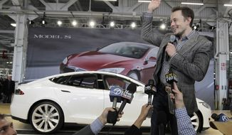 FILE - In this June 22, 2012 file photo, Tesla CEO Elon Musk waves during a rally at the Tesla factory in Fremont, Calif. Tesla Motors has selected Nevada for a massive, $5 billion factory that it will build to pump out batteries for a new generation of electric cars, a person familiar with the company's plans said Wednesday, Sept. 3, 2014. (AP Photo/Paul Sakuma, File)