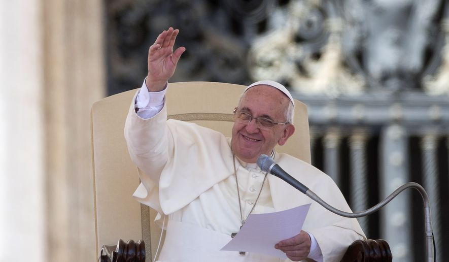 Pope Francis waves during as he delivers his message during the weekly general audience in St. Peter's Square at the Vatican, Wednesday, Sept. 3, 2014. (AP Photo/Alessandra Tarantino)