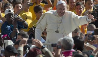 Pope Francis waves to the crowd from his popemobile as he arrives for his weekly general audience in St. Peter's Square at the Vatican, Wednesday, Sept. 3, 2014. (AP Photo/Alessandra Tarantino)