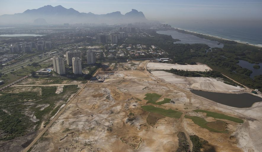 FILE - This June 27, 2014 file photo, shows an aerial view of the Rio 2016 Olympic golf course under construction in Rio de Janeiro, Brazil. Rio de Janeiro's Olympic golf course faces an uncertain future after a court proposed Wednesday Sept. 3 2014, that the under-construction layout should be modified to meet environmental concerns. Judge Eduardo Klausner, hearing a lawsuit brought against the city of Rio de Janeiro and the course developer, said the defendants had to return on Sept. 17 to say if they could accept the proposal. Klausner said work on the course could continue, but no new areas of vegetation could be plowed under. (AP Photo/Leo Correa, File)