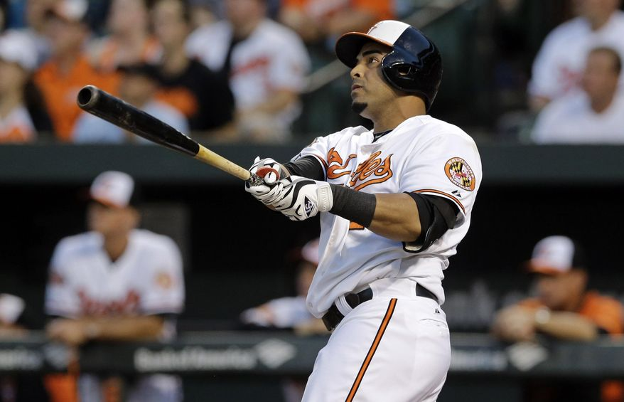 Baltimore Orioles' Nelson Cruz watches his two-run home run in the first inning of an interleague baseball game against the Cincinnati Reds, Thursday, Sept. 4, 2014, in Baltimore. (AP Photo/Patrick Semansky)