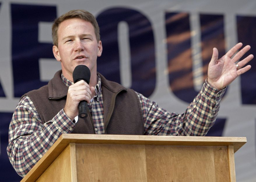 FILE - In this Saturday, Oct. 30, 2010 file photo, Ohio Secretary of State Jon Husted speaks during a rally at the Muskingum County Fairgrounds in Zanesville, Ohio. A federal judge on Thursday, Sept. 4, 2014 temporarily blocked an Ohio law that scales back early voting, ordering the state's elections chief to set additional voting times just ahead of the fall election. The ruling from U.S. District Judge Peter Economus comes in a lawsuit filed by civil rights groups, predominantly black churches and others challenging two early-voting measures in the perennial presidential battleground state. One is a directive from Husted that established uniform early-voting times and restricted weekend and evening hours. (AP Photo/Jay LaPrete)