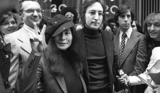 FILE - In this April 18, 1972, file photo, John Lennon and his wife, Yoko Ono, leave a U.S. Immigration hearing in New York City. The argument over President Barack Obama's legal authority to defer deportations begins 42 years ago with a bit of hashish, a dogged lawyer and, yes, John Lennon and Yoko Ono. Lennon was facing deportation from a Nixon administration eager to disrupt the ex-Beatle's planned concert tour and voter registration drive. The case hinged on Lennon's 1968 conviction for possession of cannabis resin in London. Lennon ultimately succeeded. The case's legacy is an integral part of the legal foundation Obama relied on in 2012 to set up a program that has deferred the deportation of more than 580,000 immigrants who entered the country illegally as children.   (AP Photo)