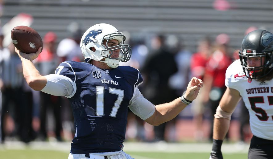 Nevada's Cody Fajardo (17) looks for an open receiver while being under pressure by Southern Utah's Josh Talbot (57) during the first half of an NCAA college football game on Saturday, Aug. 30, 2014, in Reno, Nev. (AP Photo/Cathleen Allison)