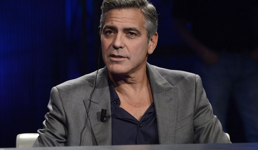 """FILE - This Sunday, Feb. 9, 2014 file photo George Clooney is interviewed by Fabio Fazio during the Italian State RAI TV program """"Che Tempo che Fa"""", in Milan, Italy.  Sony Pictures announced Wednesday, Sept. 3, 2014 that   Clooney will co-produce and direct the film version of """"Hack Attack,"""" reporter Nick Davies' book about the British phone hacking scandal. (AP Photo/Giuseppe Aresu, File)"""