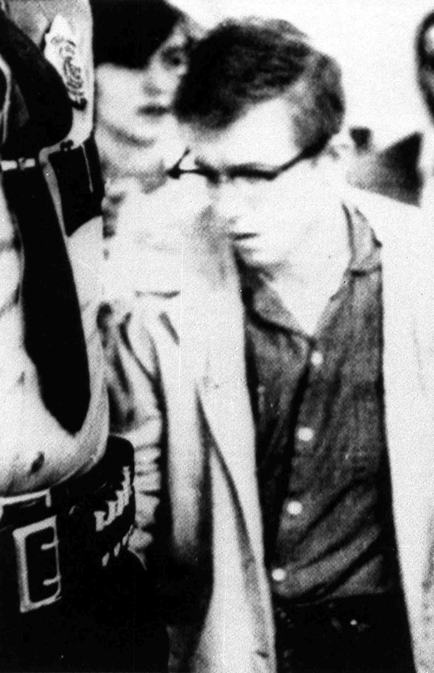 FILE - In this undated file photo, Robert Hansen leaves court in Anchorage, Alaska.  The remains of an unidentified victim  of serial killer Robert Hansen were being exhumed from an Anchorage gravesite, 30 years after her killer led authorities to her body near a lake north of the city. Hansen confessed to killing 17 women in the 1970s and early '80s, hunting victims down in the wilderness as if they were game. Hansen died Aug. 21 at age 75 while serving a 461-year sentence in Alaska. The exhumation at Anchorage Memorial Park Wednesday, Sept. 3, 2014, was for the remains of an unidentified woman believed to be in her late teens whose body was found April 25, 1984, near Horseshoe Lake.(AP Photo/The Anchorage Daily News, file) THE MAT-SU VALLEY FRONTIERSMAN OUT