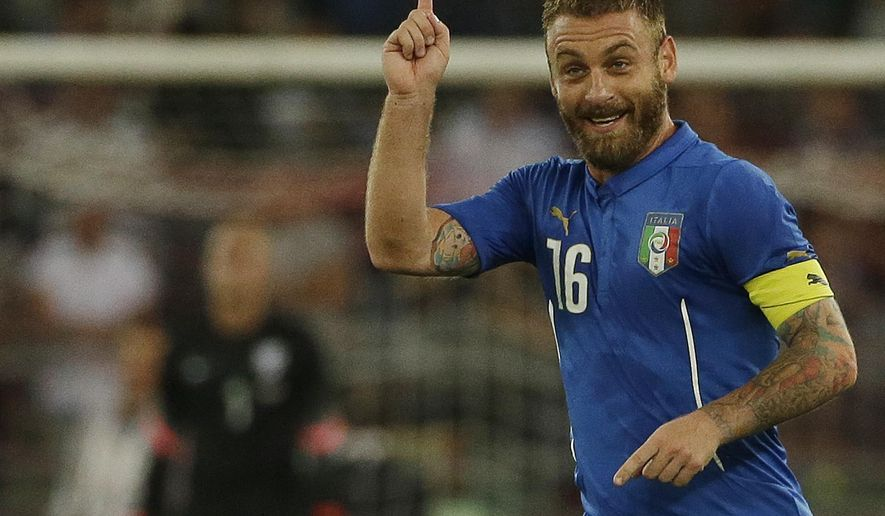 Italy's Daniele De Rossi celebrates after scoring during a friendly soccer match between Italy and The Netherlands in Bari, Italy, Thursday, Sept. 4, 2014. (AP Photo/Gregorio Borgia)