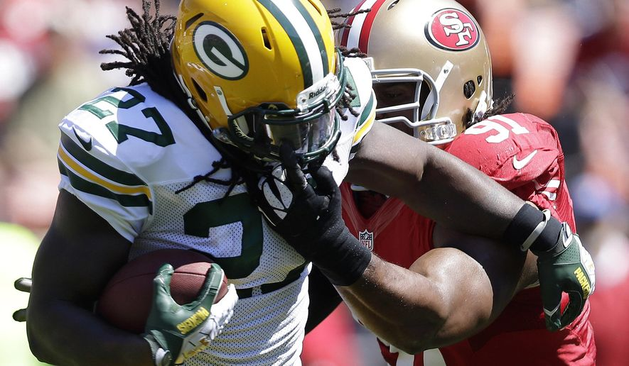 "FILE - In this Sept. 8, 2013, file photo, Green Bay Packers running back Eddie Lacy (27) runs against San Francisco 49ers defensive tackle Ray McDonald (91) during the first half of an NFL football game in San Francisco. Only days after NFL Commissioner Roger Goodell cracked down on domestic violence offenses with far harsher penalties, McDonald might just become the first known case. He faces felony domestic violence charges for an incident during his 30th birthday party with teammates and friends Sunday, Aug. 31, 2014, when police say his alleged victim suffered ""visible injuries."" (AP Photo/Marcio Jose Sanchez, File)"