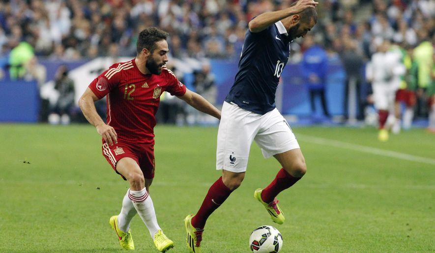 France's Karim Benzema, right, vies for the ball with Spain's Daniel Carvajal during their international friendly soccer match at the Stade de France in Saint Denis, outside Paris, Thursday, Sept. 4, 2014. (AP Photo/Thibault Camus)