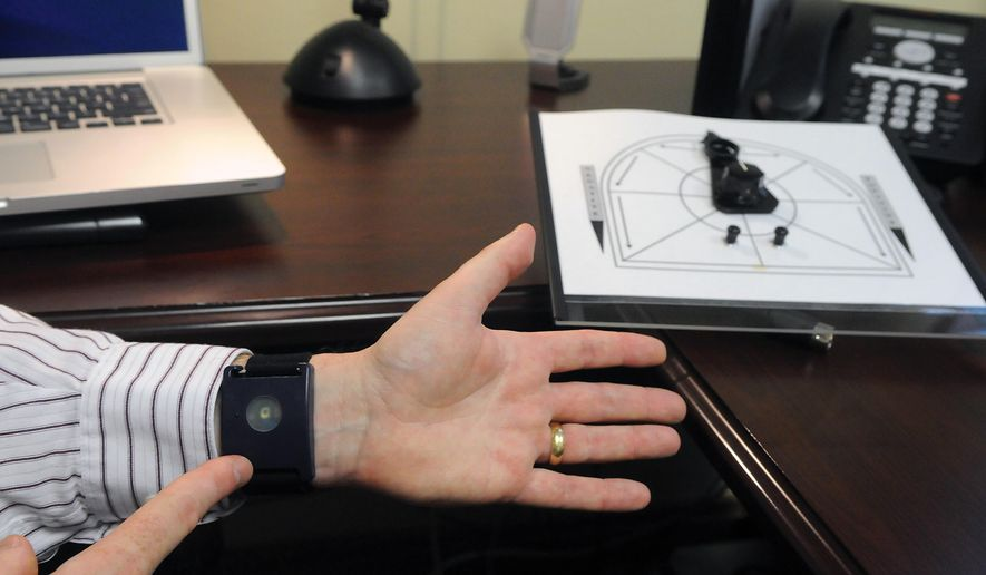 ADVANCE FOR WEEKEND EDITIONS SEPT. 6-7 - In this Aug. 27, 2014 photo, assistant professor Jason Silveira is able to monitor physical reactions to music using a device worn on the wrist in Corvallis, Ore. (AP Photo/The Corvallis Gazette-Times, Amanda Cowan)