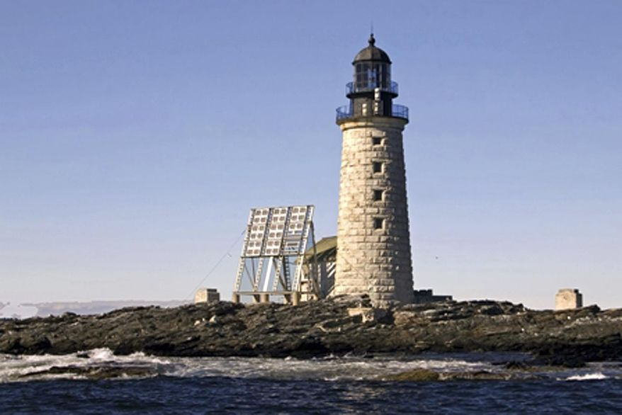This undated photo released by the federal General Services Administration shows the Halfway Rock Light Station on a small island in Casco Bay off Harpswell, Maine. The administration is the nearing the end of an online auction for the 76-foot-high lighthouse, with a half dozen bidders and a high bid of more than $200,000. (AP Photo/General Services Administration, Jeremy D'Entremont)