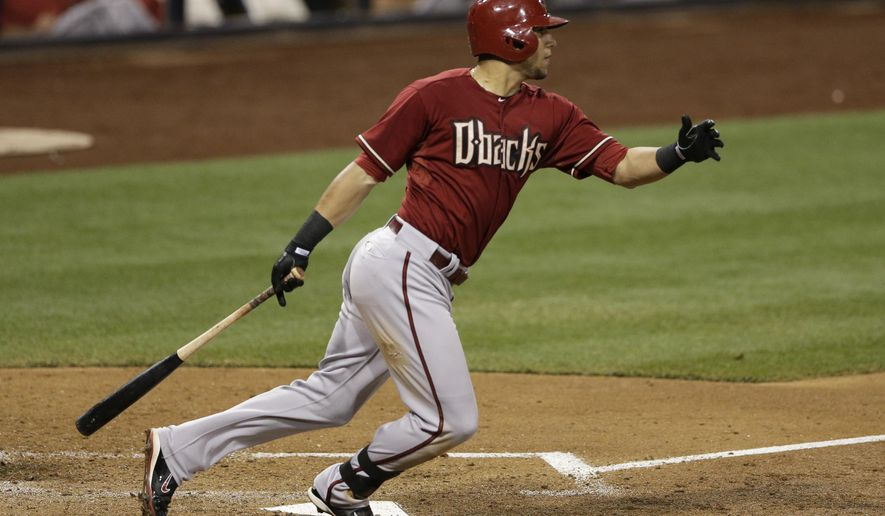 Arizona Diamondbacks' David Peralta watches his RBI single against the San Diego Padres during the fifth inning of a baseball game Wednesday, Sept. 3, 2014, in San Diego. (AP Photo/Gregory Bull)
