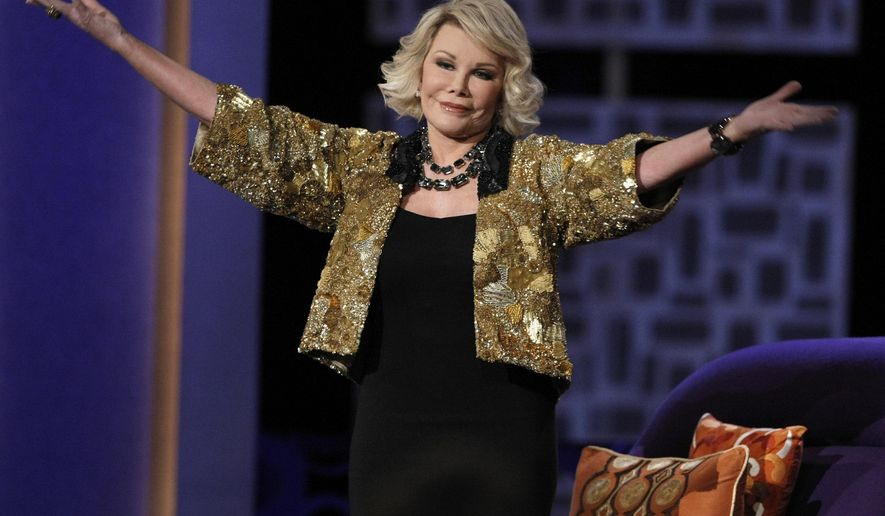 """FILE - In this Sunday, July 26, 2009 file photo, Joan Rivers greets the audience at the """"Comedy Central Roast of Joan Rivers"""" in Los Angeles. Rivers, the raucous, acid-tongued comedian who crashed the male-dominated realm of late-night talk shows and turned Hollywood red carpets into danger zones for badly dressed celebrities,  died Thursday, Sept. 4, 2014. She was 81. Rivers was hospitalized Aug. 28, after going into cardiac arrest at a doctor's office. (AP Photo/Dan Steinberg, File)"""